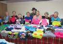 Senior citizens knit for the needy