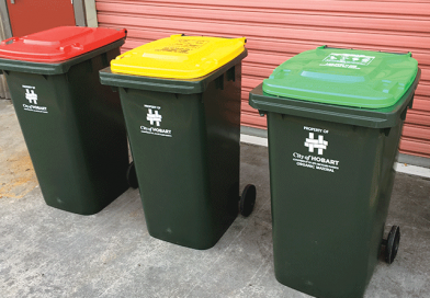 Red-lidded rubbish bins roll out across Hobart